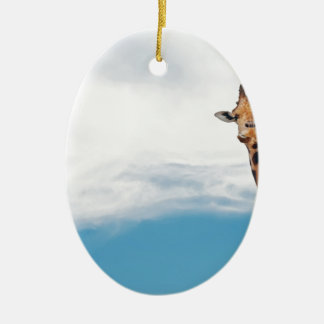 Giraffe neck and head against the clear blue sky ceramic ornament
