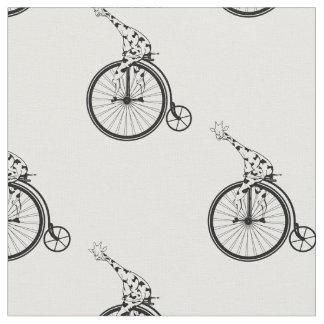 Giraffe riding a penny farthing bike fabric