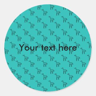 Giraffes on turquoise pattern round stickers