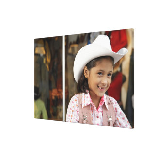 Girl (8-10) wearing stetson, smiling canvas print