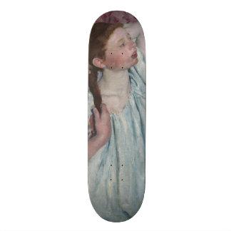 Girl Arranging Her Hair by Mary Cassatt Skate Deck