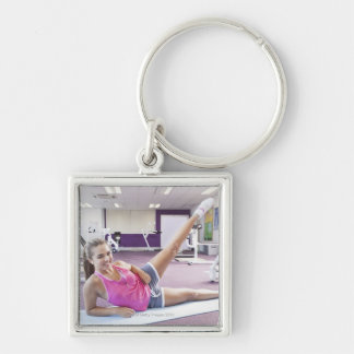 Girl Exercising in Gym Key Chain