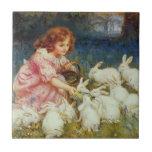 Girl feeding rabbites ceramic tiles