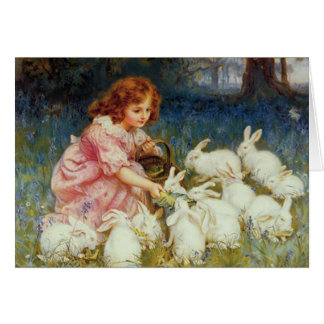 Girl feeding Rabbits Greeting Card