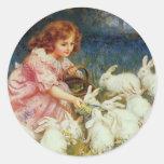 Girl feeding Rabbits Round Sticker