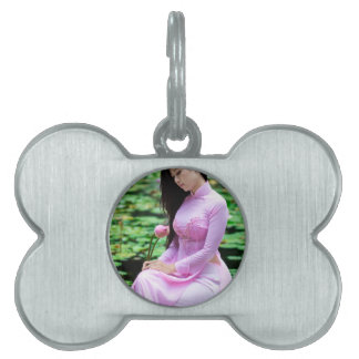 Girl holding lotus at the fountain pet name tags