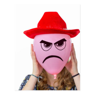 Girl holding pink balloon with angry face and hat postcard