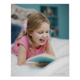 Girl laying in bed reading book poster