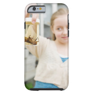Girl looking at insect in jar in classroom tough iPhone 6 case