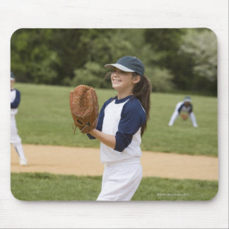 Girl pitching in little league softball game mousepads