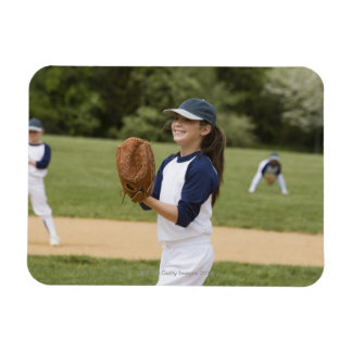 Girl pitching in little league softball game magnets