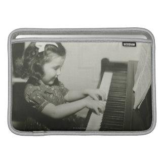Girl Playing Piano MacBook Sleeve