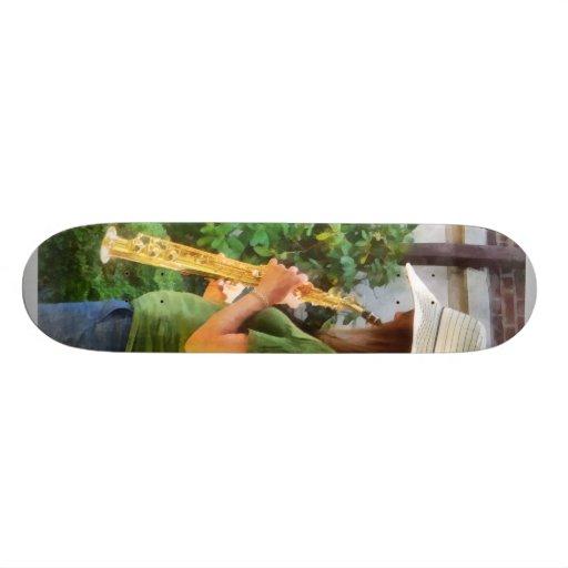 Girl Playing Saxophone Skate Boards