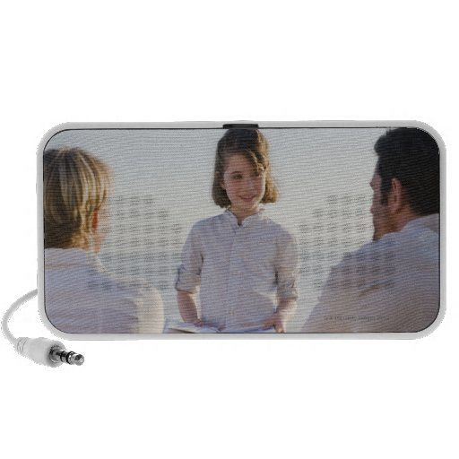 Girl reading a book in front of her parents travel speaker