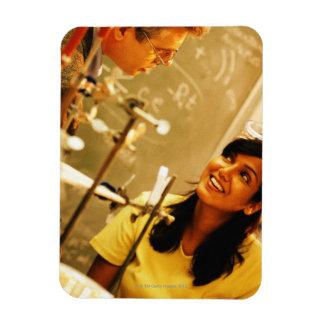 Girl smiling at teacher in chemistry lab rectangular photo magnet