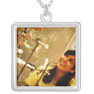 Girl smiling at teacher in chemistry lab silver plated necklace