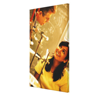 Girl smiling at teacher in chemistry lab stretched canvas prints