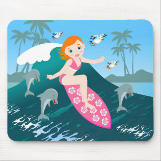Girl surfing a big wave with dolphins mouse pad