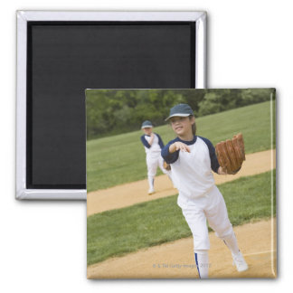 Girl throwing in little league softball game magnet