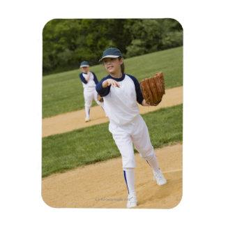 Girl throwing in little league softball game rectangular photo magnet