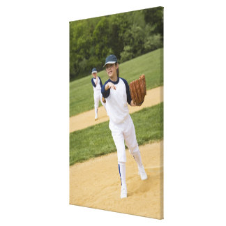Girl throwing in little league softball game stretched canvas print