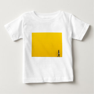 Girl Walking Against Enormous Yellow Wall Baby T-Shirt