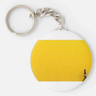 Girl Walking Against Enormous Yellow Wall Key Ring