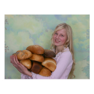 Girl with loafs of bread postcard