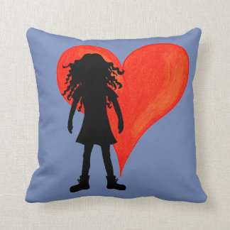 Girl with long curly hair and big heart cushion