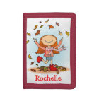 Girl with red boots playing in leaves name wallet