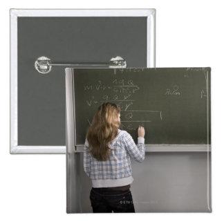 Girl writing on blackboard 15 cm square badge