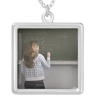 Girl writing on blackboard silver plated necklace