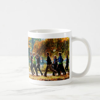Girls Jogging On an Autumn Day Mugs