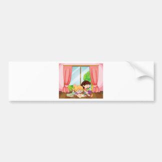 Girls reading book bumper stickers
