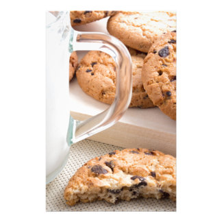 Glass cup with milk and oatmeal cookies stationery