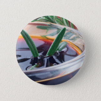 Glass cup with soy sauce and rosemary 6 cm round badge