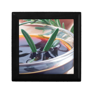 Glass cup with soy sauce and rosemary gift box