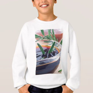 Glass cup with soy sauce and rosemary sweatshirt