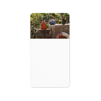 Glass fishing floats red blu on wooden boxes scene address label