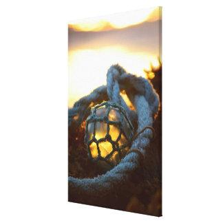 Glass float glows at sunset, Alaska Canvas Print