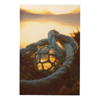 Glass float glows at sunset, Alaska Wood Wall Art