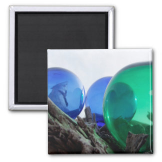 Glass floats on gray driftwood square magnet