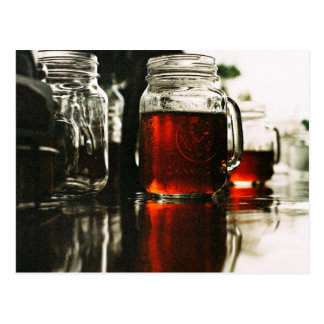 Glass jars filled with Wine Postcard