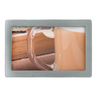 Glass mug with hot chocolate and biscuits belt buckles
