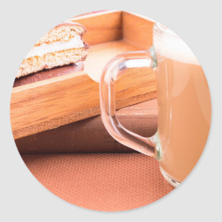 Glass mug with hot chocolate and biscuits classic round sticker