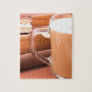 Glass mug with hot chocolate and biscuits jigsaw puzzle