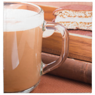 Glass mug with hot chocolate and biscuits napkin