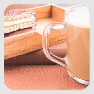 Glass mug with hot chocolate and biscuits square sticker