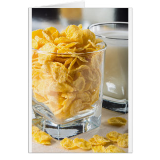 Glass of dry cereal and a glass of milk card