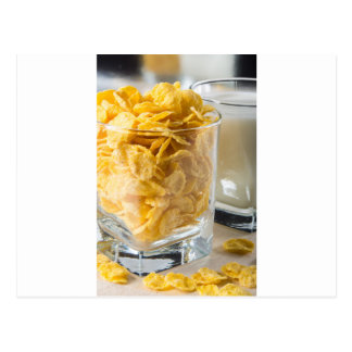Glass of dry cereal and a glass of milk postcard